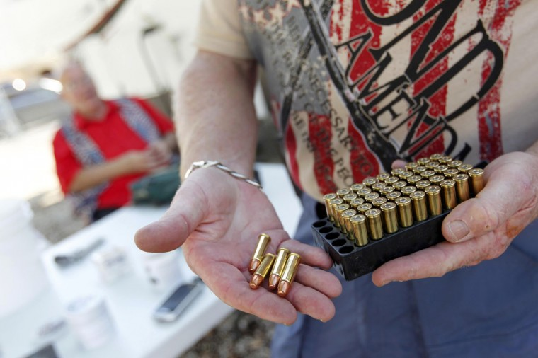 Doug Varrieur displays some .38 caliber ammunition on the firing range he set up in the yard of his home in Big Pine Key in the Florida Keys March 5, 2014. Varrieur, 57, discovered a little-noticed part of Florida law which prohibits local governments from restricting gun rights in any way, and in December he set up a personal gun range on his property in a residential subdivision. Neighbors were outraged by the live gunfire, but their surprise was nothing compared to that of municipal leaders, who were shocked to realize there was nothing they could do about it. Picture taken March 5, 2014. (REUTERS/Andrew Innerarity)