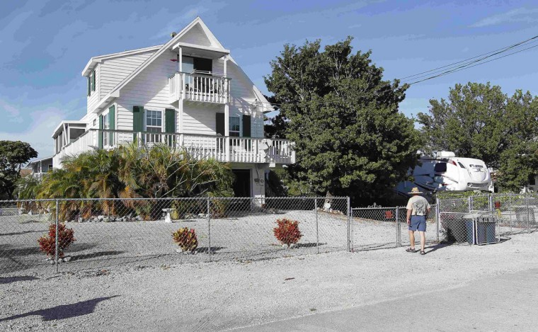 Doug Varrieur walks to his home in Big Pine Key in the Florida Keys March 5, 2014. Varrieur, 57, discovered a little-noticed part of Florida law which prohibits local governments from restricting gun rights in any way, and in December he set up a personal gun range on his property in a residential subdivision. Neighbors were outraged by the live gunfire, but their surprise was nothing compared to that of municipal leaders, who were shocked to realize there was nothing they could do about it. Picture taken March 5, 2014. (REUTERS/Andrew Innerarity)