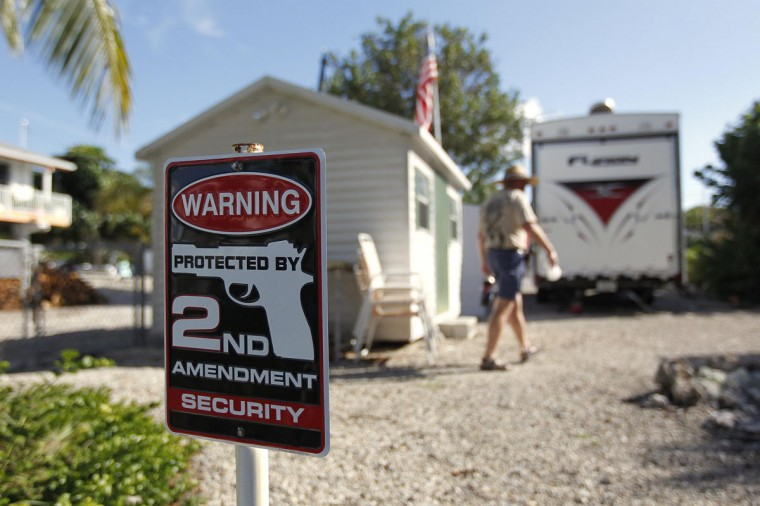 Doug Varrieur walks behind the backstop of his practice firing range in the yard of his home in Big Pine Keys in the Florida Keys March 5, 2014. Varrieur, 57, discovered a little-noticed part of Florida law which prohibits local governments from restricting gun rights in any way, and in December he set up a personal gun range on his property in a residential subdivision. Neighbors were outraged by the live gunfire, but their surprise was nothing compared to that of municipal leaders, who were shocked to realize there was nothing they could do about it. Picture taken March 5, 2014. (REUTERS/Andrew Innerarity)