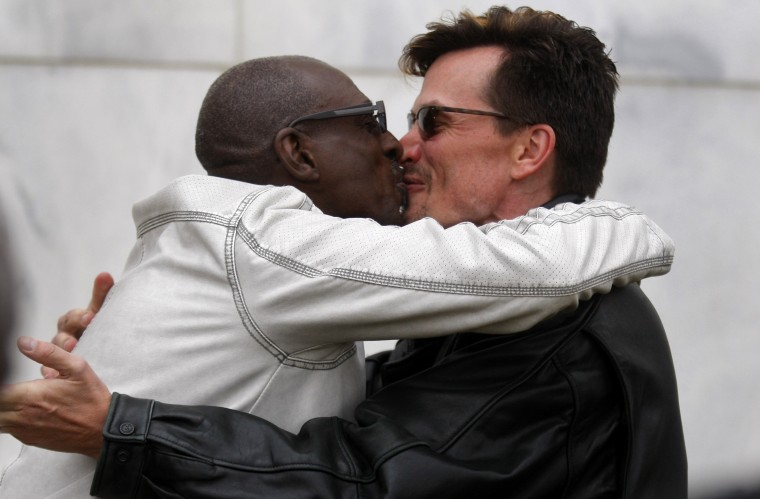Newly married Roland Smith and Paul Mattson kiss after their brief wedding ceremony outside the Oakland County Courthouse a day after a Federal judge ruled a Michigan's ban on same-sex marriage violated the U.S. Constitution. (Rebecca Cook/Reuters)