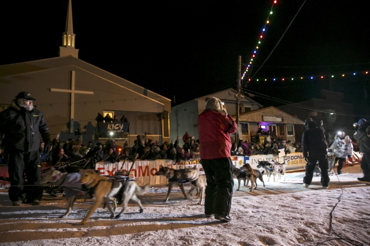 Aliy Zirkle pulls into the finish line in second place only 2 minutes and 22 seconds behind winner Dallas Seavey during the Iditarod dog sled race in Nome, Alaska, March 11, 2014. The nearly 1,000-mile (1,600-km) Iditarod Trail Sled Dog Race commemorates a 1925 rescue mission that carried diphtheria serum by sled-dog relay to the coastal community of Nome, which remains the final destination in this 42nd edition of the event. REUTERS/Nathaniel Wilder (UNITED STATES - Tags: SPORT ANIMALS SOCIETY) ORG XMIT: ANC107