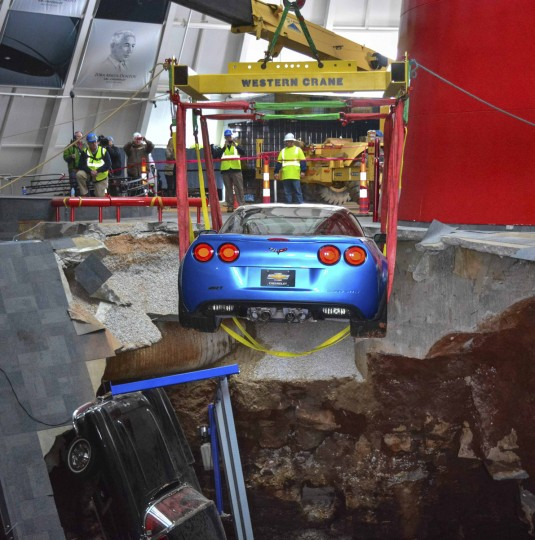 "Workers use a crane to recover the first Chevrolet Corvette, the 2009 Corvette ZR-1 ""Blue Devil,"" from the sinkhole at the National Corvette Museum in Bowling Green, Kentucky in this March 3, 2014 picture provided by Chevrolet. The 40-foot (12-metre) sinkhole opened up under museum in Kentucky on February 12, 2014 and swallowed eight collector cars, including the historic one millionth Corvette built in 1992. (Adam Boca/Chevrolet/Handout via Reuters)"