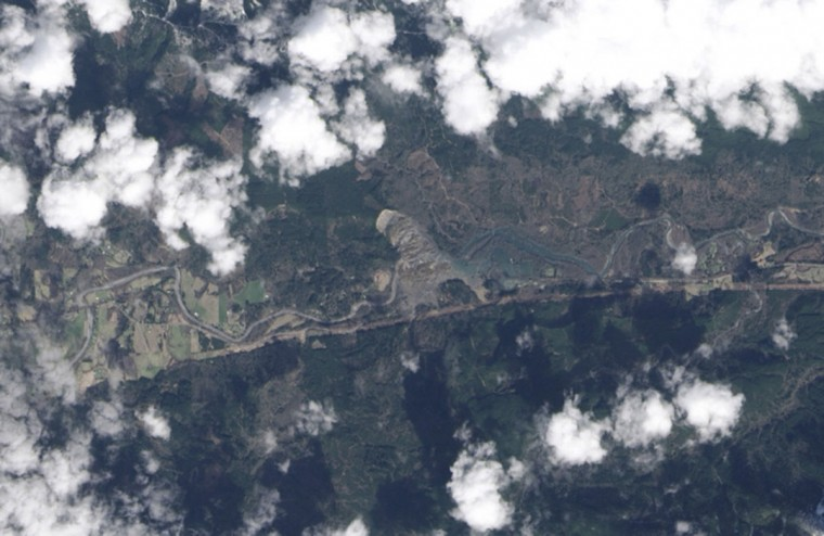 The rainfall-triggered landslide which sent muddy debris spilling across the North Fork of the Stillaguamish River, near Oso, Washington is seen in a NASA Earth Observatory image from the Landsat 8 satellite taken March 23, 2014. Washington State officials were hoping on Wednesday to cut the numbers on a list of scores of people missing after a weekend landslide, one of the deadliest in recent U.S. history, that has killed an estimated 24 people. (NASA Earth Observatory/Handout via Reuters)