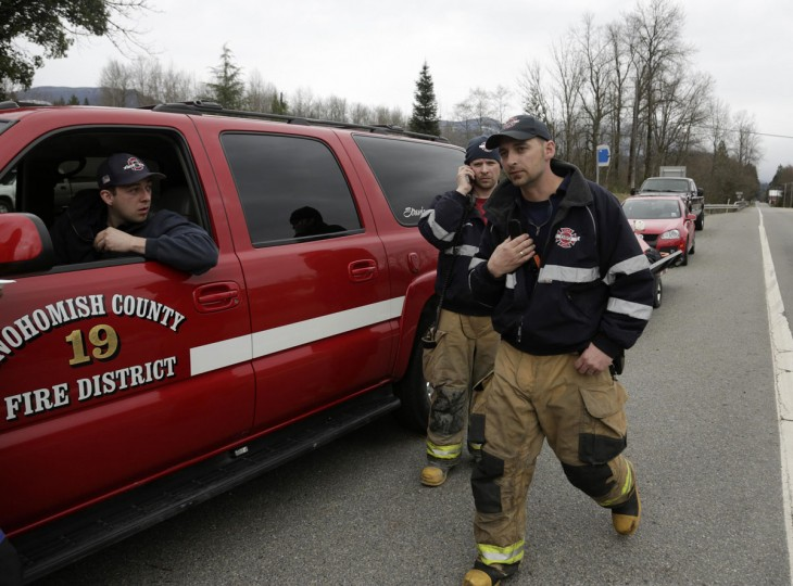 Members of a swift water rescue team monitor radio traffic after a large mudslide blocked Highway 530 near Oso, Washington, March 22, 2014. (Jason Redmond/Reuters)