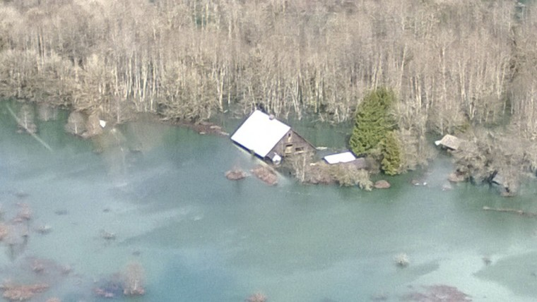 An aerial view of the area affected by a landslide near State Route 530 is seen in this handout photo provided by the Governor Jay Inslee's office taken near Oso, Washington, March 23, 2014. (Gov. Jay Inslee's office/Handout photo via Reuters)
