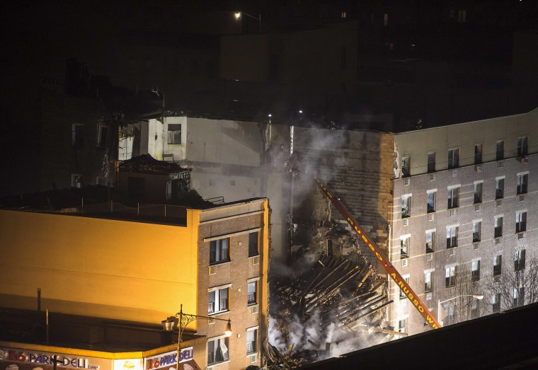 New York City firefighters work at the site of an explosion and collapse of two buildings in the Harlem section of New York, March 12, 2014. Two New York City buildings collapsed on Wednesday in an explosion believed to be caused by a gas leak, killing two people, injuring at least 36, and setting off a search for more victims feared trapped in the rubble, officials said. (REUTERS/Eric Thayer)
