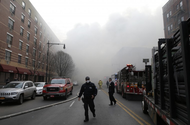 Smoke fills East 116th street near an apparent building explosion fire and collapse in the Harlem section of New York City, March 12, 2014. A building collapsed in a largely residential block of Upper Manhattan on Wednesday and the New York City Fire Department was searching for anyone trapped in the debris, officials said. (REUTERS/Mike Segar)
