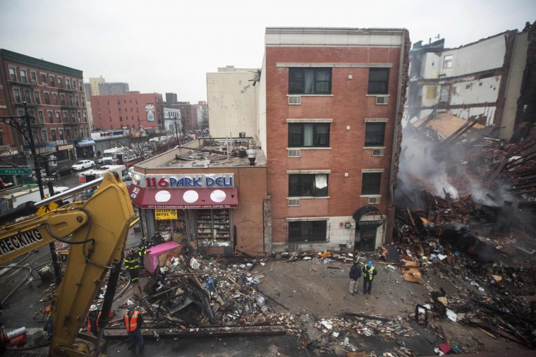 New York City emergency responders work at the site of an explosion and collapse of two buildings in the Harlem section of New York, March 12, 2014. Two New York City buildings collapsed on Wednesday in an explosion believed to be caused by a gas leak, killing two people, injuring at least 36, and setting off a search for more victims feared trapped in the rubble, officials said. (REUTERS/Brendan McDermid)