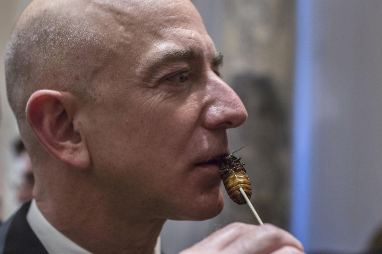 Amazon chairman and CEO Jeff Bezos samples cooked cockroach at the 110th Explorers Club Annual Dinner at the Waldorf Astoria in New York. The club, which promotes the scientific exploration of land, sea, air and space featured catering by chef and exotic creator Gene Rurka. Chef Rurka prepared a variety of dishes featuring an array of insects, wildlife, animal body parts and invasive species. (Andrew Kelly/Reuters)