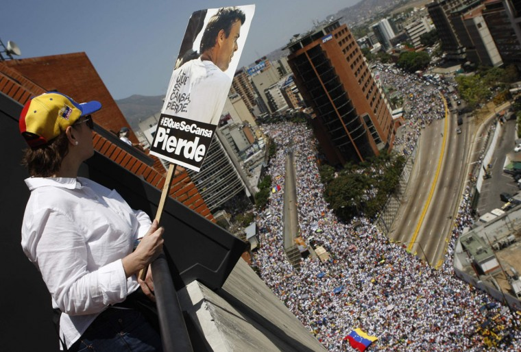An opposition supporter watches a protest against Venezuela's President Nicolas Maduro's government in Caracas March 22, 2014. (Christian Veron/Reuters)