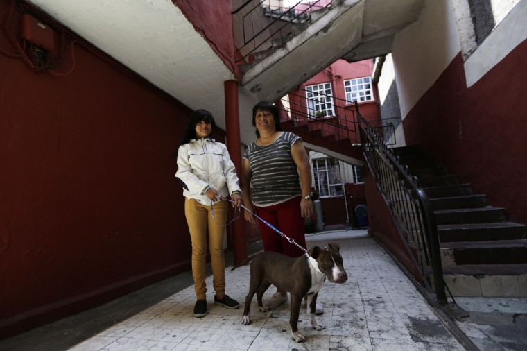 Rosaura Realsola, 51, poses for a photograph with her daughter Alexandra Yamileth, 13, in front of their home in Tepito in Mexico City February 20, 2014. Rosaura is a domestic cleaner, who finished her education at age 16. She says that when she was a child, she wanted to be a teacher when she grew up. Rosaura hopes that her daughter Alexandra will become a nurse. Alexandra will finish education in 2023 and says she wants to be a nurse when she grows up. On March 8 activists around the globe celebrate International Women's Day, which dates back to the beginning of the 20th century and has been observed by the United Nations since 1975. The UN writes that it is an occasion to commemorate achievements in women's rights and to call for further change. Picture taken February 20, 2014. (REUTERS/Henry Romero)
