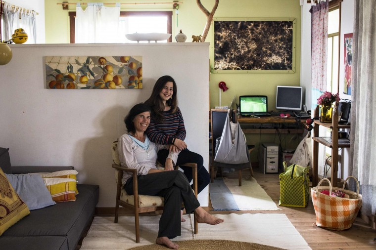 Vered, 43, poses for a photograph with her daughter Alma, 13, in their home in Kibbutz Hukuk near the Sea of Galilee in northern Israel March 3, 2014. Vered got a degree in design at the age of 27 and currently runs educational art projects in local communities. Vered hopes that her daughter Alma will find a profession that brings her happiness and satisfaction. Alma will graduate high-school in five years, at the age of 18. She says she would like to be a part of the film industry, as a director, as camerawoman, an editor or an actress. On March 8 activists around the globe celebrate International Women's Day, which dates back to the beginning of the 20th century and has been observed by the United Nations since 1975. The UN writes that it is an occasion to commemorate achievements in women's rights and to call for further change. Picture taken March 3, 2014. (REUTERS/Nir Elias)