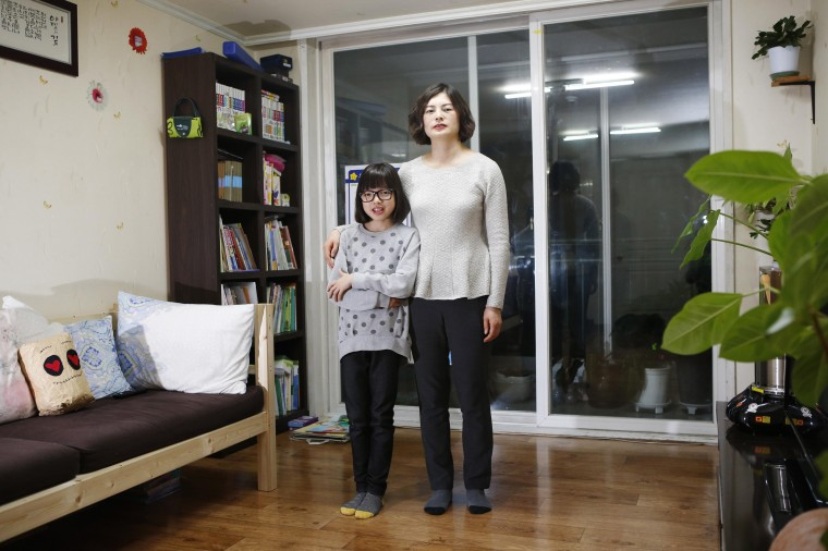 Kang Hyun-jeong, 43, and her daughter Yoo Ha-min, 11, pose for a photograph in the living room of their apartment in Seoul February 21, 2014. Kang Hyun-jeong works in accounts. She says that she started working in her senior year of high school, but she began a business degree in 1999 at the Korea National Open University because she wanted to study more. She juggled work and classes and graduated eight years later in 2007. She hopes to get a masters degree when her children grow up. Kang Hyun-jeong says her children are talented in the arts but she knows that the reality is that it is difficult to make money through art. She's worried about that, but still wants to root for their dreams. Her daughter Yoo Ha-min says she wants to be a designer or a painter when she grows up. On March 8 activists around the globe celebrate International Women's Day, which dates back to the beginning of the 20th century and has been observed by the United Nations since 1975. The UN writes that it is an occasion to commemorate achievements in women's rights and to call for further change. Picture taken February 21, 2014. (REUTERS/Kim Hong-Ji)