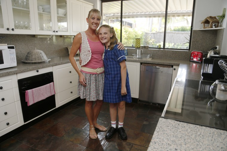 Kylie Glass, 40, and her daughter Abby Glass, 12, pose for a picture in Caringbah, Sydney February 18, 2014. Kylie finished school at age 17 and now has a job training childcarers. She says that when she was growing up, she wanted to work with children. Kylie says she just wants her daughter to be healthy and happy. Abby says that she enjoys anything to do with science so might want to be a forensic policewoman or else do something completely different like become a hairdresser. On March 8 activists around the globe celebrate International Women's Day, which dates back to the beginning of the 20th century and has been observed by the United Nations since 1975. The UN writes that it is an occasion to commemorate achievements in women's rights and to call for further change. Picture taken February 18, 2014. (REUTERS/Jason Reed)