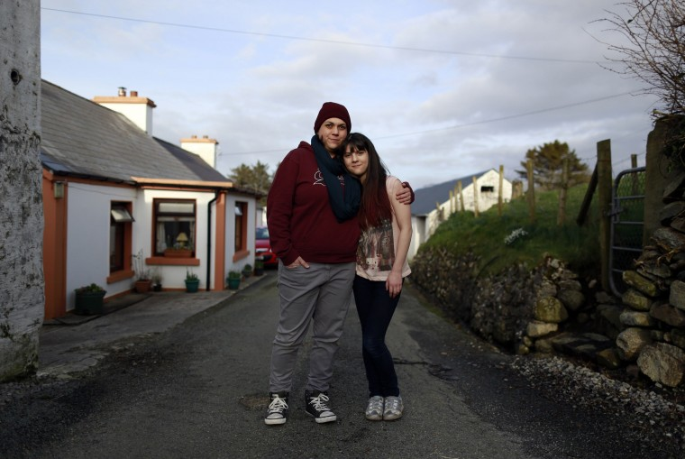 Clare Barrett Butler, 37, and her daughter Lily Barrett McHugh, 11, pose for a photograph outside their house in a small hamlet near the village of Ardara in County Donegal February 27, 2014. Clare says she is a homemaker and a mother, and she is continuing her education with courses at college. Clare says that as a child she wanted to work on the special effects of movies or as a stuntwoman. She says that she would love her daughter Lily to follow her dreams and become a hairdresser. Lily says she thinks she'll stay in education until she is about 20, and she would really like to become a hairdresser. On March 8 activists around the globe celebrate International Women's Day, which dates back to the beginning of the 20th century and has been observed by the United Nations since 1975. The UN writes that it is an occasion to commemorate achievements in women's rights and to call for further change. Picture taken February 27, 2014. (REUTERS/Cathal McNaughton)