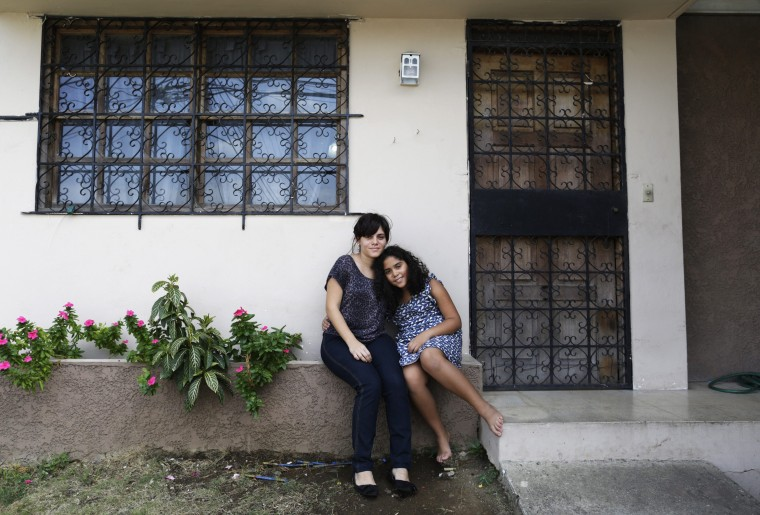 Marisa del Carmen Moreno, 30, and her daughter Alicia Isabel Santa Maria, 10, pose for a photograph outside their home in Panama City February 13, 2014. Marisa is an architect. She finished her education at age 29. When she was a child she wanted to become a veterinarian. She hopes her daughter will grow up to become an artist. Marisa's daughter Alicia Isabel hopes to go to university and would like to become a chef or a painter. On March 8 activists around the globe celebrate International Women's Day, which dates back to the beginning of the 20th century and has been observed by the United Nations since 1975. The UN writes that it is an occasion to commemorate achievements in women's rights and to call for further change. Picture taken February 13, 2014. (REUTERS/Carlos Jasso)