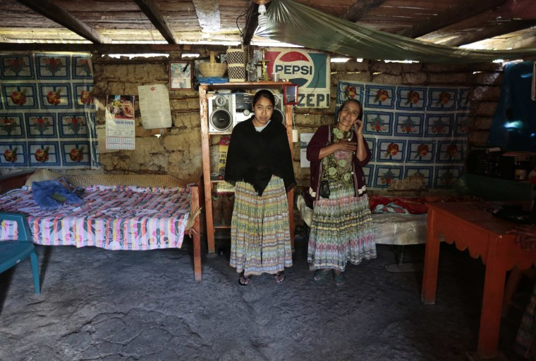 Alicia Chiquin, 43, and her daughter Fidelina Ja, 18, pose for a photograph at their home in Pambach, Guatemala February 20, 2014. Alicia has no education and has always worked the land. Her daughter Fidelina also has no education and when she grows up she says she will continue to work at home and on the land. On March 8 activists around the globe celebrate International Women's Day, which dates back to the beginning of the 20th century and has been observed by the United Nations since 1975. The UN writes that it is an occasion to commemorate achievements in women's rights and to call for further change. Picture taken February 20, 2014. (REUTERS/Jorge Dan Lopez)