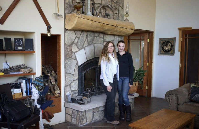 Denise Arthur, 52, and her daughter Linnaea Thibedeau, 13, pose for a photograph at their home near Blackhawk, Colorado February 20, 2014. Denise Arthur is a restoration ecologist. She has a Ph.D and finished her education at age 34. Her ambition as a child was to be an animal behaviourist. Denise hopes her daughter Linnaea will become a biologist when she grows up. Linnaea would like to get a Ph.D and become a marine biologist. On March 8 activists around the globe celebrate International Women's Day, which dates back to the beginning of the 20th century and has been observed by the United Nations since 1975. The UN writes that it is an occasion to commemorate achievements in women's rights and to call for further change. Picture taken February 20, 2014. (REUTERS/Rick Wilking)