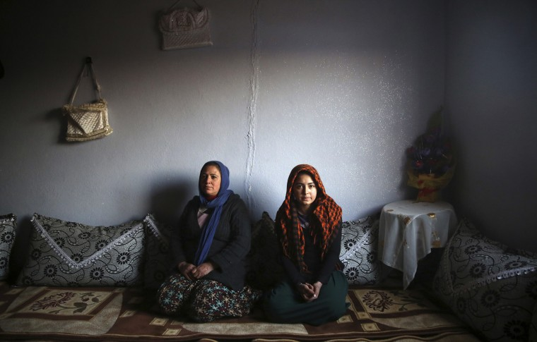 Tahsiye Ozyilmaz, 33, and her daughter Halime, 14, pose for a photograph at their home in Zeytinpinar Village of Derik, a Kurdish town in Mardin Province February 1, 2014. Tahsiye, who is a housewife, didn't go to school. She says would have liked to become a teacher, but she had an arranged marriage at the age of 17. She wants her daughter to finish her education, and would like her to be a doctor. Halime stopped going to school last year because it was 10 km (6 miles) from her house and the journey was too difficult. Halime says she would have liked to become a doctor, but now this is impossible. She says she thinks she will have an arranged marriage when she is 17 or 18, like her mother did. On March 8 activists around the globe celebrate International Women's Day, which dates back to the beginning of the 20th century and has been observed by the United Nations since 1975. The UN writes that it is an occasion to commemorate achievements in women's rights and to call for further change. Picture taken February 1, 2014. (REUTERS/Umit Bektas)