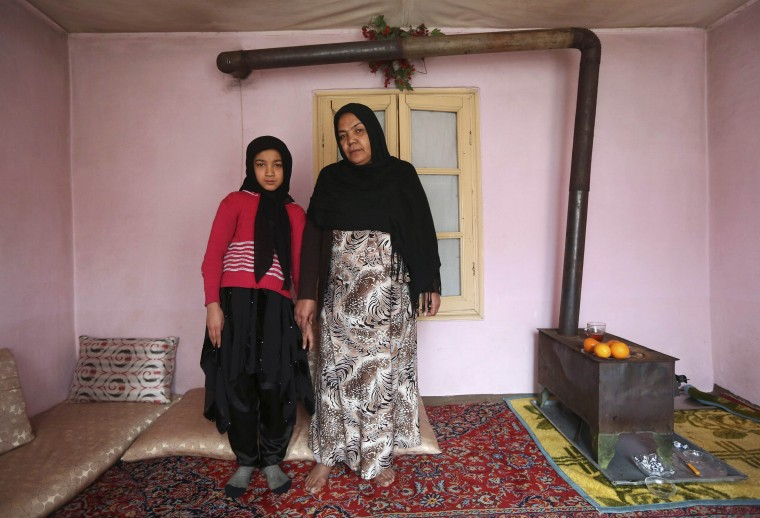 Noor Zia, 40, poses for a photograph with her daughter Saba Ahmadi, 11, at their home in Kabul February 13, 2014. Noor, who is a teacher, studied until she was 28. Her ambition was to become a doctor, but she couldn't afford the fees. She hopes her daughter will become a well-known, highly skilled doctor. Saba wants to go to university, and would like to become a renowned lawyer. On March 8 activists around the globe celebrate International Women's Day, which dates back to the beginning of the 20th century and has been observed by the United Nations since 1975. The UN writes that it is an occasion to commemorate achievements in women's rights and to call for further change. Picture taken February 13, 2014. (REUTERS/Omar Sobhani)