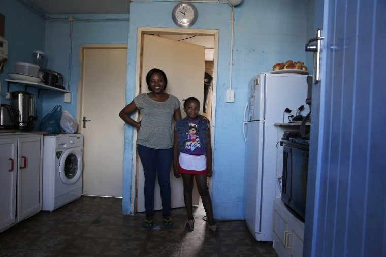 Thozama Kala, 30, and her daughter Mpho, 9, pose for a photograph in the kitchen of their home in Cape Town's Langa township February 8, 2014. Thozama is studying office management after matriculating in 2002. She hopes that her daughter will become a doctor. Mpho says she wants to be a teacher. On March 8 activists around the globe celebrate International Women's Day, which dates back to the beginning of the 20th century and has been observed by the United Nations since 1975. The UN writes that it is an occasion to commemorate achievements in women's rights and to call for further change. Picture taken February 8, 2014. (REUTERS/Mike Hutchings)