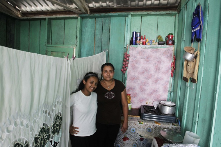 Susana Maria Cardona, 33, and her daughter Alejandra Ruby Cardona, 12, pose for a photograph inside their home in Tegucigalpa February 20, 2014. Susana Maria, who is a housewife, finished school at 17. Her ambition was to become a lawyer. She hopes that her daughter will become a doctor. Alejandra Ruby will finish education in 11 years and hopes to be an agronomist. On March 8 activists around the globe celebrate International Women's Day, which dates back to the beginning of the 20th century and has been observed by the United Nations since 1975. The UN writes that it is an occasion to commemorate achievements in women's rights and to call for further change. Picture taken February 20, 2014. (REUTERS/Jorge Cabrera)