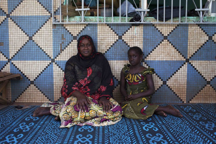 Oumou Ndiaye, 30, and her daughter Aissata Golfa, 9, pose for a picture in their house in Bamako, Mali February 20, 2014. Oumou, who is a housewife, did not go to school. As a child she hoped to marry a local businessman. She hopes her daughter will marry someone from their ethnic group when she grows up, and that she will stay in education until she is 20 years old. Aissata says that she will finish school when she is 18, and hopes to be a schoolteacher when she grows up.On March 8 activists around the globe celebrate International Women's Day, which dates back to the beginning of the 20th century and has been observed by the United Nations since 1975. The UN writes that it is an occasion to commemorate achievements in women's rights and to call for further change. Picture taken February 20, 2014. (REUTERS/Joe Penney)