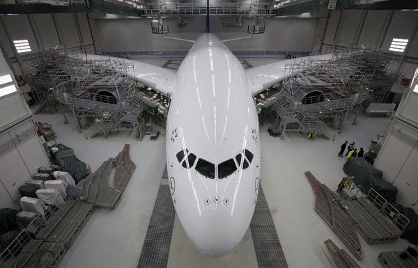 A new Airbus A380 airliner for Lufthansa is ready to leave the paintshop hangar at the Airbus facility in Finkenwerder near Hamburg on February 5, 2010. (REUTERS/Christian Charisius)