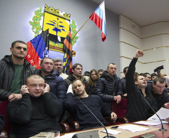 Protest leader Pavel Gubarev (second left, front) and other pro-Russian demonstrators hold a meeting after entering the regional government building in Donetsk, on March 3, 2014. (Reuters photo)