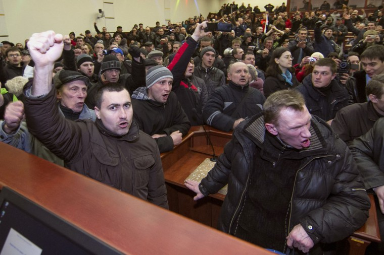 Pro-Russian demonstrators hold a meeting after entering the regional government building in Donetsk on March 3, 2014. (Reuters photo)