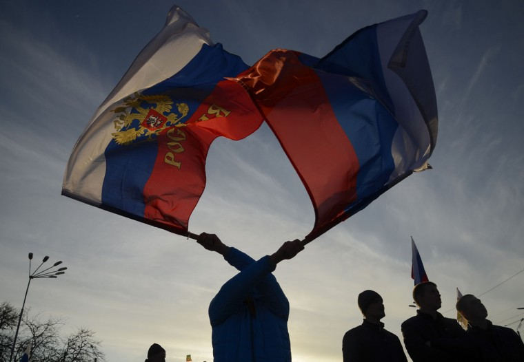 Pro-Russian demonstrators take part in a rally in the Crimean town of Yevpatoria on March 5, 2014. (REUTERS/Maks Levin)