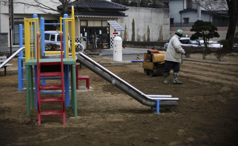 A man uses a roller near a Geiger counter, measuring a radiation level of 0.207 microsievert per hour, during nuclear radiation decontamination work at a park in Koriyama, west of the tsunami-crippled Fukushima Daiichi nuclear power plant, Fukushima prefecture on February 27, 2014. (REUTERS/Toru Hanai)