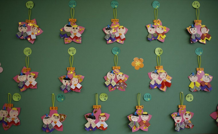"""Paper crafts of Japanese ornamental """"hina"""" dolls, made by children, are displayed on a wall at the Emporium kindergarten in Koriyama, west of the tsunami-crippled Fukushima Daiichi nuclear power plant, Fukushima prefecture on February 28, 2014. (REUTERS/Toru Hanai)"""