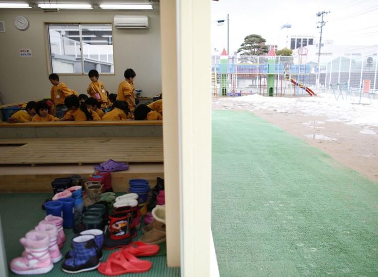 Children play at an indoor sand pit of the Emporium kindergarten in Koriyama, west of the tsunami-crippled Fukushima Daiichi nuclear power plant, Fukushima prefecture on February 28, 2014. (REUTERS/Toru Hanai)