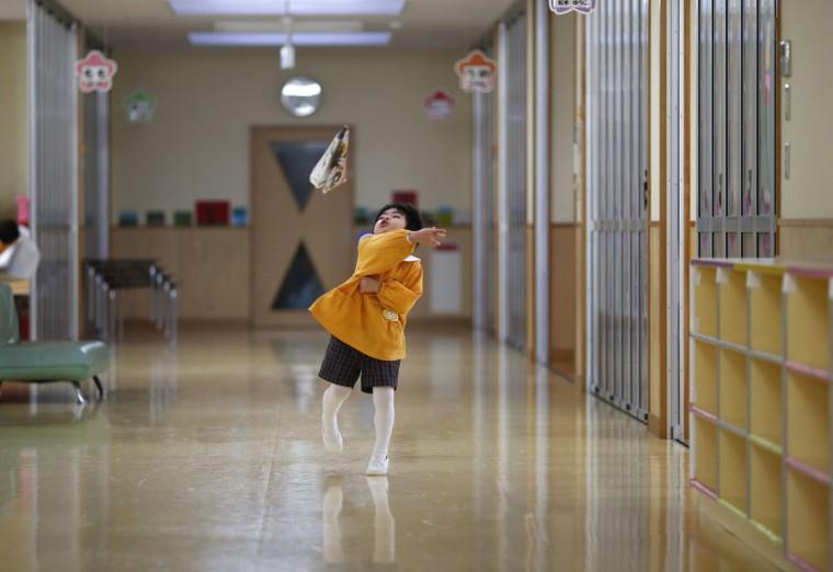 A boy plays with a paper plane at the corridor of the Emporium kindergarten in Koriyama, west of the tsunami-crippled Fukushima Daiichi nuclear power plant, Fukushima prefecture on February 28, 2014. (REUTERS/Toru Hanai)