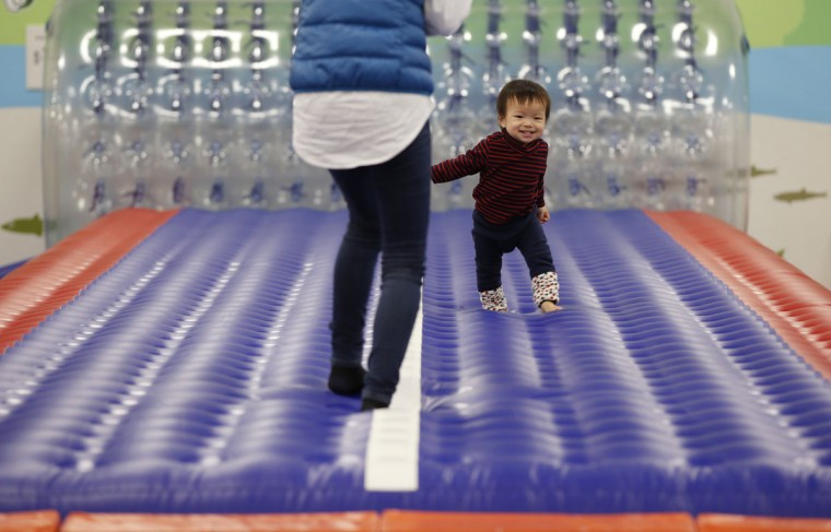 One-year-old Daichi Toyota plays with his mother at an indoor playground which was built for children and parents who refrain from playing outside because of concerns about nuclear radiation in Koriyama, west of the tsunami-crippled Fukushima Daiichi nuclear power plant, Fukushima prefecture on February 27, 2014. (REUTERS/Toru Hanai)