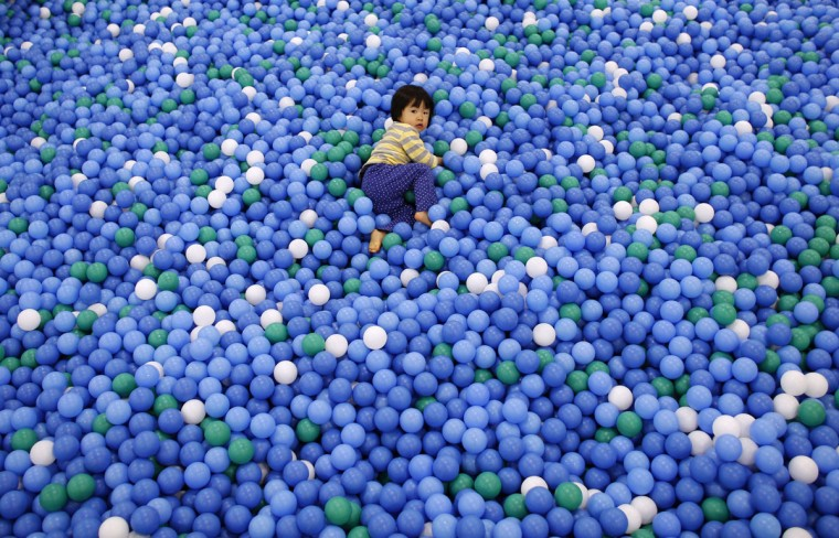 Two-year-old Nao Watanabe plays in a ball pit at an indoor playground that was built for children and parents who refrain from playing outside because of concerns about nuclear radiation in Koriyama, west of the tsunami-crippled Fukushima Daiichi nuclear power plant, (REUTERS/Toru Hanai)