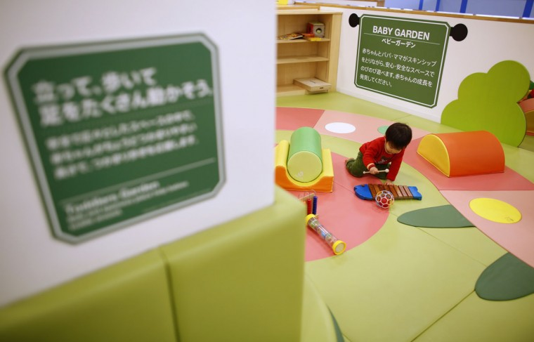 Two-year-old Sakuya Zui plays at an indoor playground built for children and parents who refrain from playing outside because of concerns about nuclear radiation in Koriyama, west of the tsunami-crippled Fukushima Daiichi nuclear power plant, Fukushima prefecture on February 27, 2014. (REUTERS/Toru Hanai)