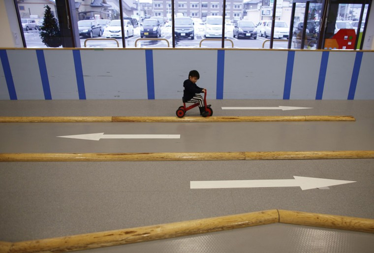 Four-year-old Iori Hiyama rides a tricycle at an indoor playground built for children and parents who refrain from playing outside because of concerns about nuclear radiation in Koriyama, west of the tsunami-crippled Fukushima Daiichi nuclear power plant, Fukushima prefecture on February 27, 2014. (REUTERS/Toru Hanai)