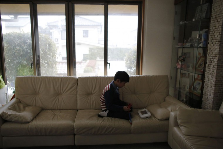Seven-year-old Masyoshi Kaneta plays Nintendo Wii U game at a living room of his home in Koriyama, west of the tsunami-crippled Fukushima Daiichi nuclear power plant, Fukushima prefecture on February 28, 2014. (REUTERS/Toru Hanai)