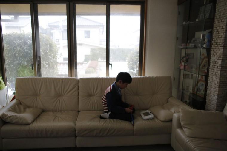 Seven-year-old Masyoshi Kaneta plays Nintendo Wii U game at a living room of his home in Koriyama, west of the tsunami-crippled Fukushima Daiichi nuclear power plant, Fukushima prefecture on February 28, 2014. (REUTERS/Toru Hanai)