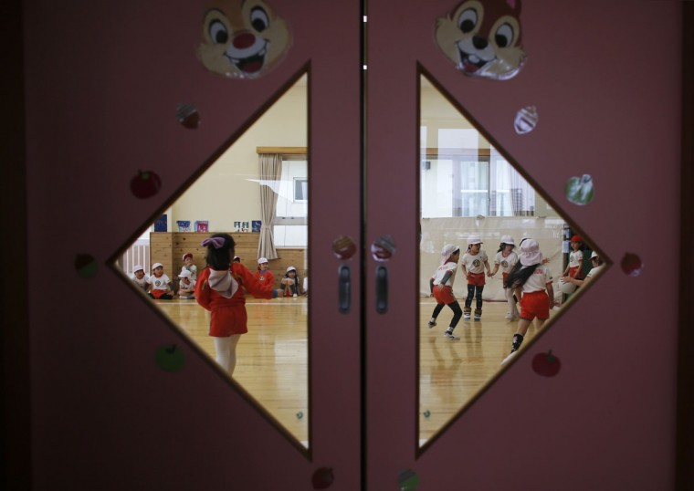 Children play dodge ball in a playroom at the Emporium kindergarten in Koriyama, west of the tsunami-crippled Fukushima Daiichi nuclear power plant, Fukushima prefecture on February 28, 2014. (REUTERS/Toru Hanai)