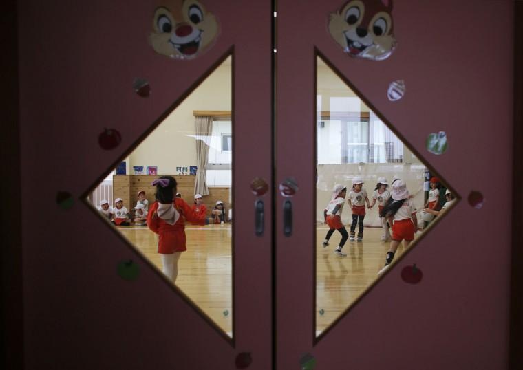 Children play dodge ball in a playroom at the Emporium kindergarten in Koriyama, west of the tsunami-crippled Fukushima Daiichi nuclear power plant, Fukushima prefecture on February 28, 2014. (REUTERS/Toru Hanai)