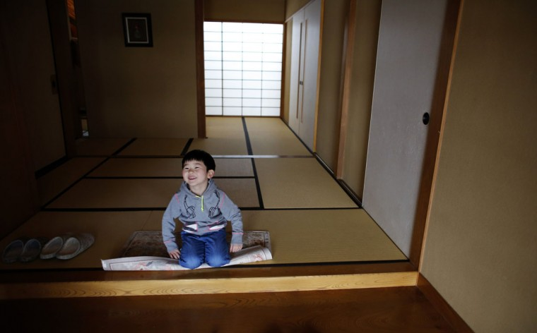 Five-year-old Atsunori Kaneta smiles at his home in Koriyama, west of the tsunami-crippled Fukushima Daiichi nuclear power plant, Fukushima prefecture on February 28, 2014. (REUTERS/Toru Hanai)
