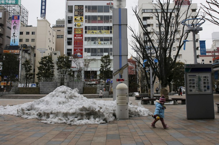 A child walks past a geiger counter, measuring a radiation level of 0.162 microsievert per hour, at a square in front of Koriyama Station in Koriyama, west of the tsunami-crippled Fukushima Daiichi nuclear power plant, Fukushima prefecture on March 1, 2014. (REUTERS/Toru Hanai)