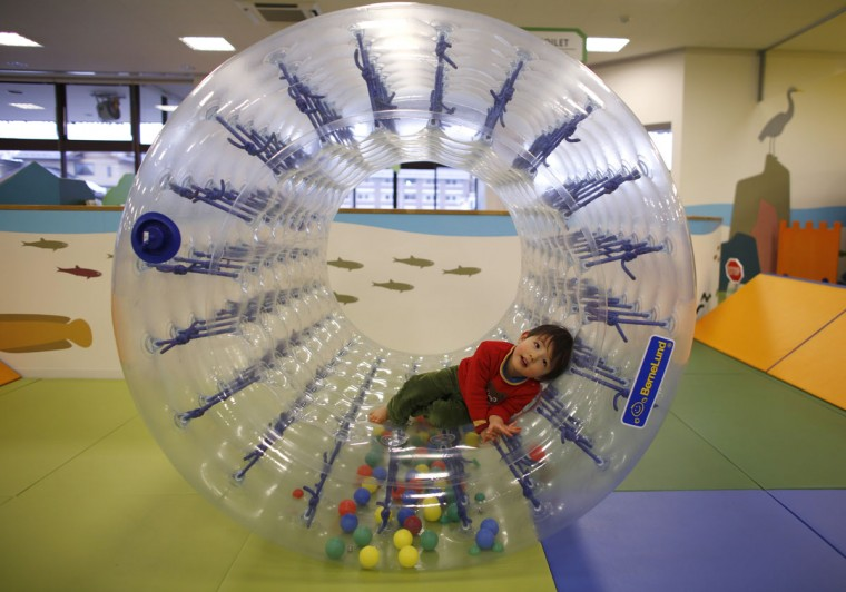 Two-year-old Sakuya Zui plays at an indoor playground which was built for children and parents who refrain from playing outside because of concerns about nuclear radiation in Koriyama, west of the tsunami-crippled Fukushima Daiichi nuclear power plant, Fukushima prefecture on February 27, 2014. (REUTERS/Toru Hanai)