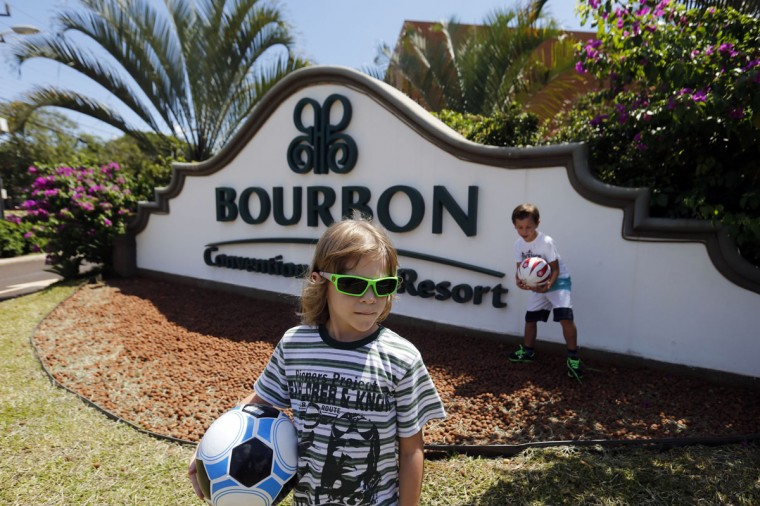 Children play in front of the Bourbon Hotel, where South Korea's national soccer team will be based during the 2014 World Cup, in Foz do Iguacu, on Brazil's southern border with Paraguay. (REUTERS/Jorge Adorno)