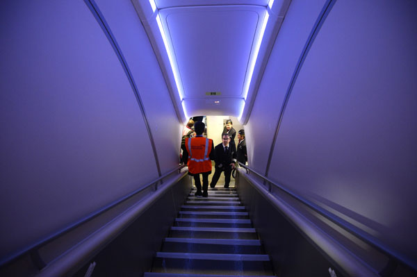 Staff use the stairs between the upper and lower decks of the British Airways Airbus A380 at Heathrow Airport in London on July 4, 2013. (REUTERS/Paul Hackett)