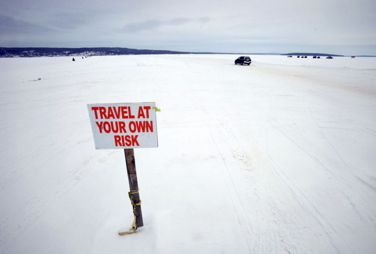 A car travels the ice road on Lake Superior between Bayfield, Wis., and Madeline Island on February 15, 2014. (REUTERS/Eric Miller)