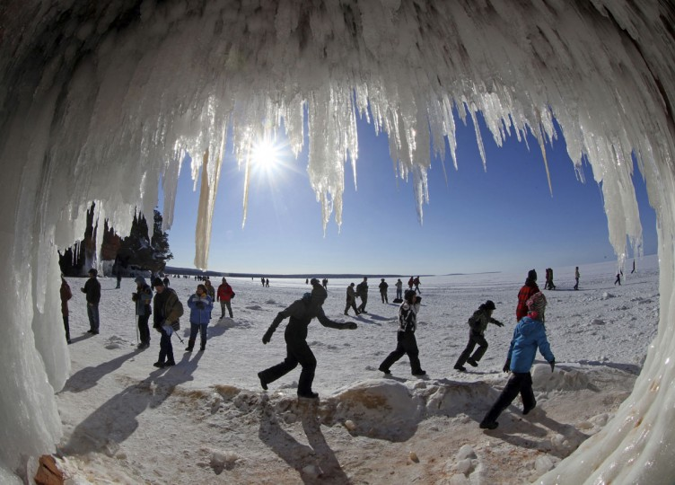 Sightseers look at icicles at the mouth of a sea cave of the Apostle Islands National Lakeshore of Lake Superior near Cornucopia, Wis., on February 14, 2014. (REUTERS/Eric Miller)